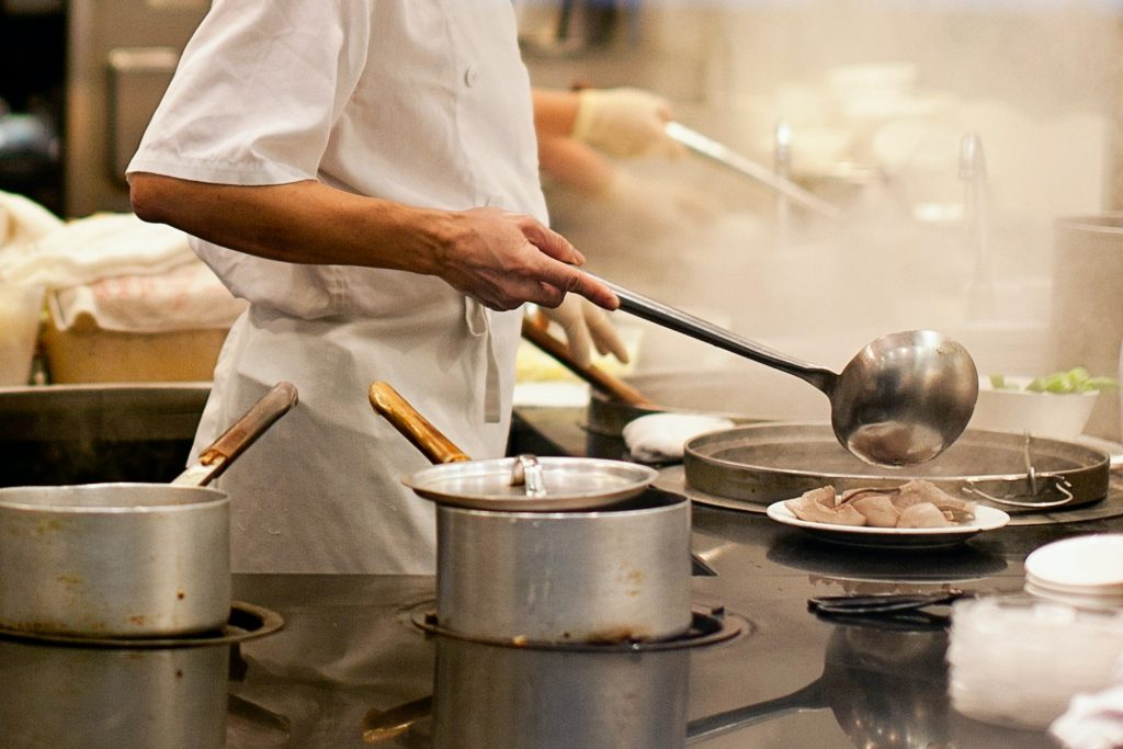 Asian chef working in commercial kitchen