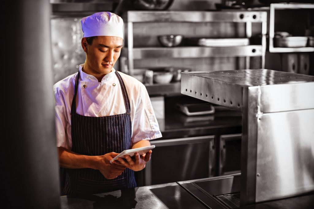Chef using digital tablet in the commercial kitchen