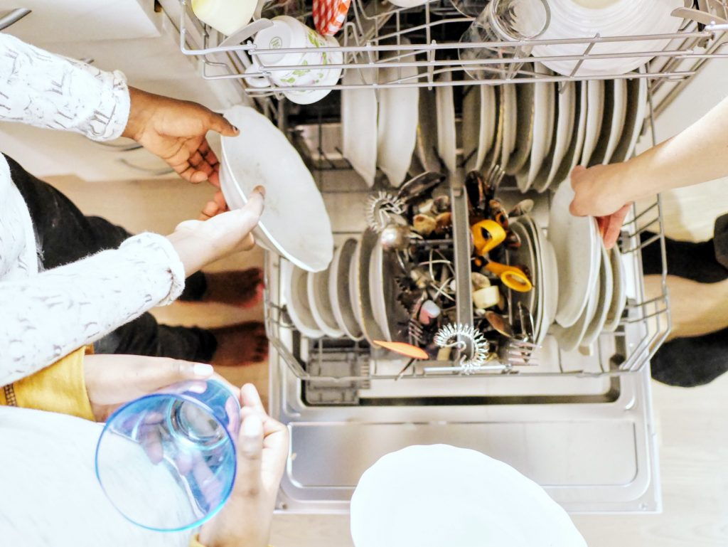 Putting the dishes into the dishwasher